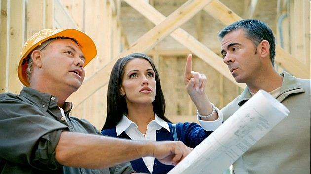 A couple talks to a contractor.